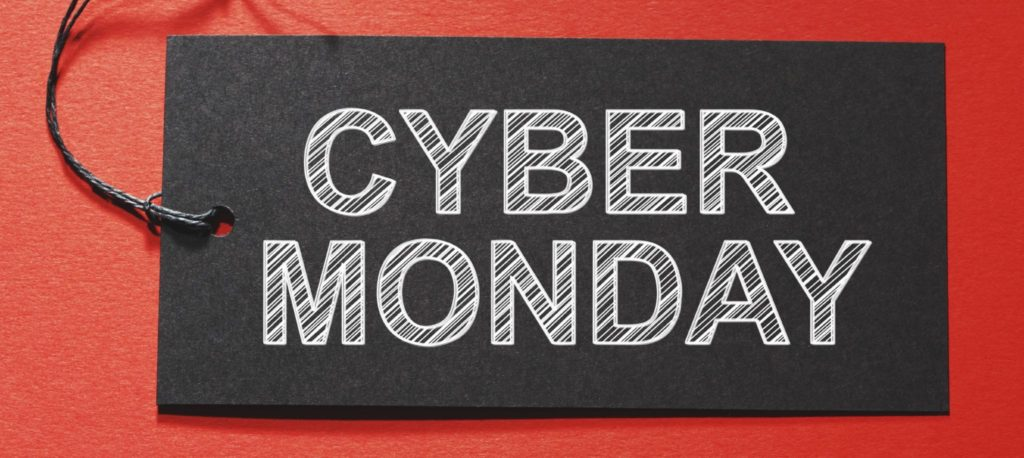Cyber Monday text on a black tag on a red paper background