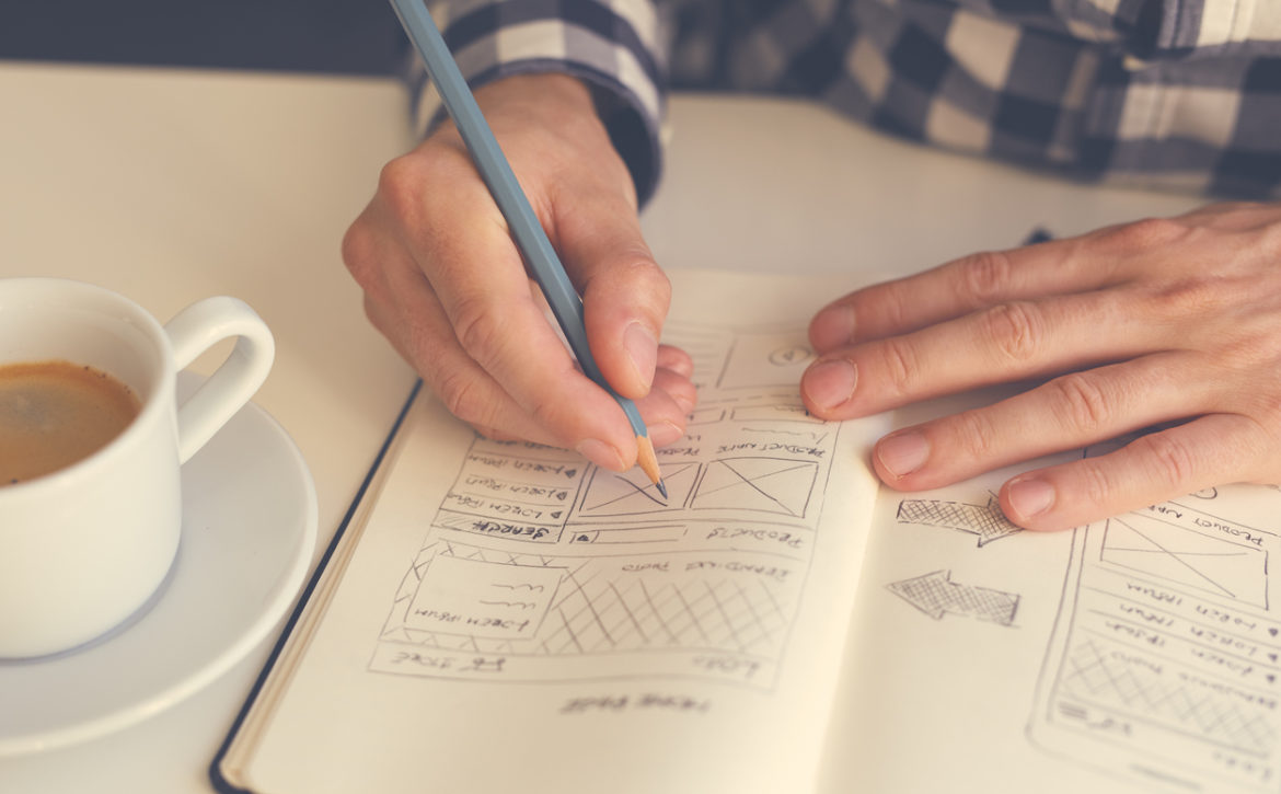 Man sketching graphic sketch in office